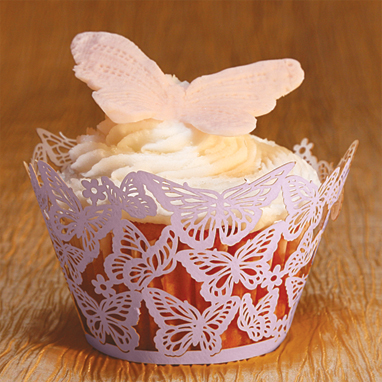 "Butterflies Cupcake Wrappers - Lavender - These unique and fun cupcake wraps are great for dressing up any Party! Give your cupcakes the added touch of a laser cut designed wrap.  Size: 3-1/4"" round x 2-1/8"" highEasily assembles to slip your favorite cupcake or candy-filled cup into for a marvelous display.  Create a beautiful cupcake tree, set at each place setting as a party favor, the possibilities are endless.Wrappers are for presentation purposes only - not to bake in."